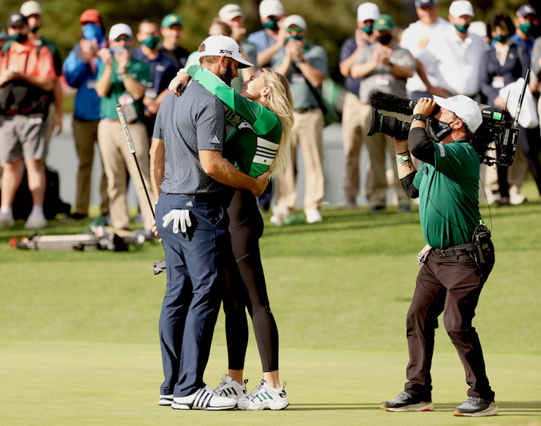 Dustin Johnson of the United States kisses fiancée Paulina Gretzky (Photo by Jamie Squire/Getty Images)